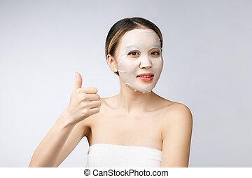 Spa, Gesundheitsversorgung. Asiatisches Mädchen mit kosmetischer Maske.