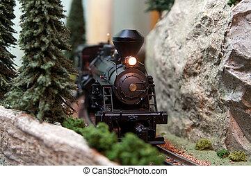 Spielzeug Lokomotive auf Bahngleis