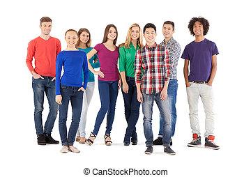 stehende , voll, leute, leute., freigestellt, junger, heiter, während, fotoapperat, beiläufig, länge, weißes, lächeln