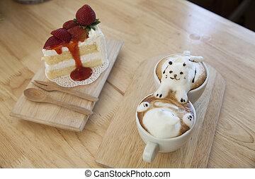 Top-Aussicht von Latte Kaffee Topping aus Milchschaum Top auf der Tasse heißen Kaffee und Erdbeerkuchen.