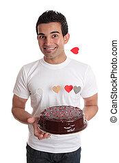 Valentinstags-Spaß, männlich mit Schokoladen-Herzkuchen