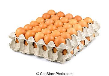 Vollständiges Tablett mit frischen, freigelegten Eiern, Eiern in Kartons.