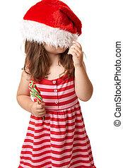 Weihnachtskind mit Santa-Hut