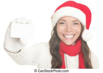 Weihnachtsmädchen zeigt Visitenkarten